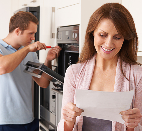 Woman Getting Her Appliances Repaired